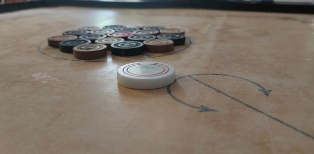How Are Points Determined in Online Carrom